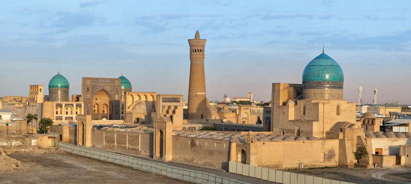 Aerial cityscape of Bukhara on sunset with Po-i-Kalan architectural complex and Kalyan minaret, Uzbekistan