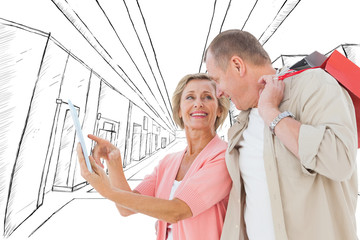 Couple with shopping bags and tablet against sketch of an office building