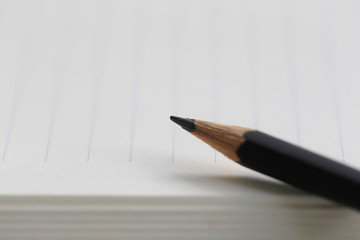 The Pencil point to the empty area of note paper.