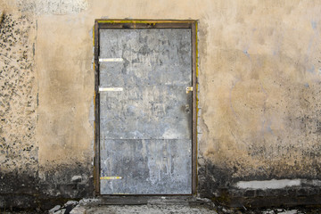 doors in an old light building, damaged wall