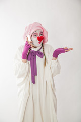 mime girl in a snowman costume with mobile phones in hands. Man with emotions on a white background.