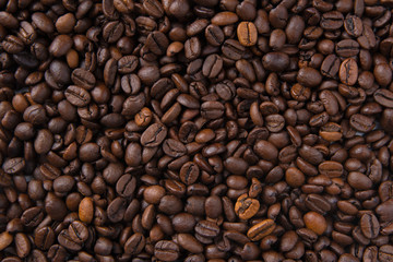 Coffee beans on wooden background. Top view.