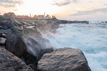 Ocean waves splash into rock Pier in Gudhjem 2