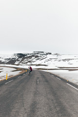 Man skating on road in mountains