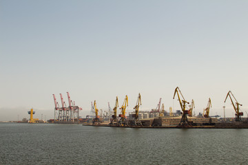 Panorama of the sea port cranes ships