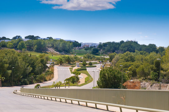 Las Colinas Golf and Country Club asphalt road perspective