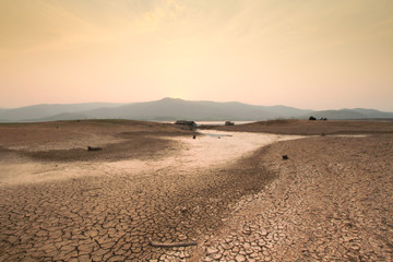 Drought and Climate change scene of dried river and cracked earth.