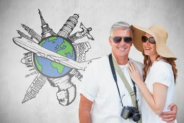 Vacationing couple against white background