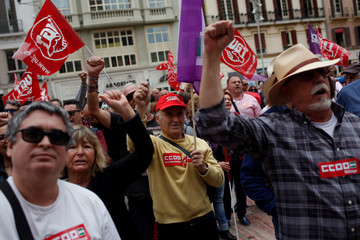 "People sing a revolutionary song titled ""The Internationale"" during a May Day rally in Malaga"