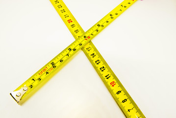 Yellow carpentry tape meter.  Meter measurement. Isolated background.