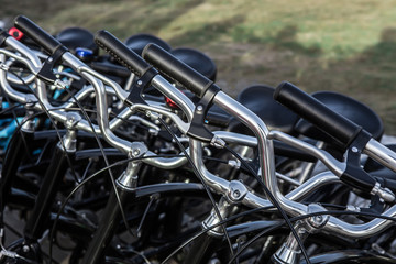 lots of black bikes in the Parking lot