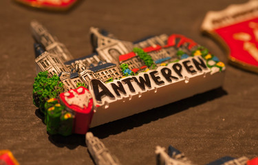 Magnet for memory in tourist souvenir shop of belgian city