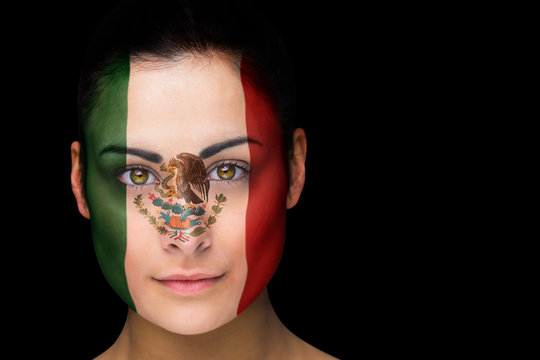 Composite image of mexico football fan in face paint against black