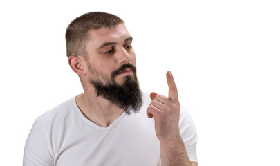 man looking at his index finger on white background with copy space