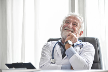 Happy Senior male Doctor is thinking.