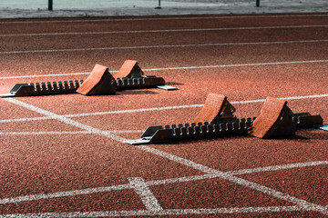 Close view of starrting blocks at cindertrack of athletics stadium