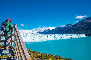 Panorama of glacier Perito Moreno in Patagonia and lonely hiker