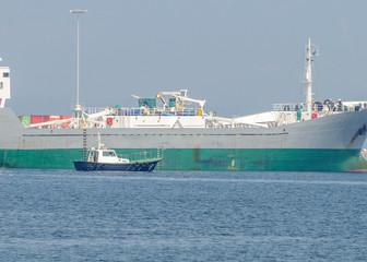 tugboat near the tanker