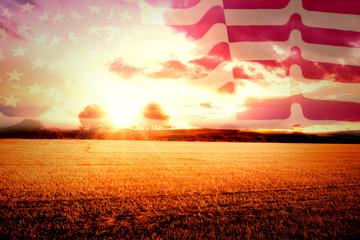 Rippled US flag against countryside scene