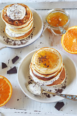 Ricotta pancakes with orange jam and chocolate, two portions