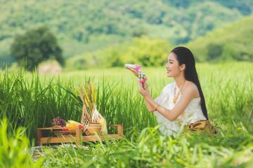 Beautiful Thai girl in Thai costume,Asian woman wearing traditional Thai culture at farmland;Thailand.