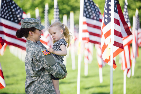 American Female soldier with a little girl