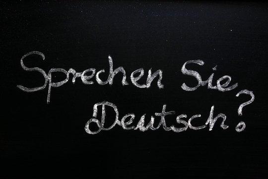 Sprechen Sie Deutsch (do you speak German) question on chalkboard