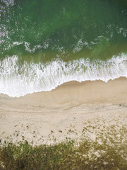 Overhead scenic view of waves flowing on shore at beach