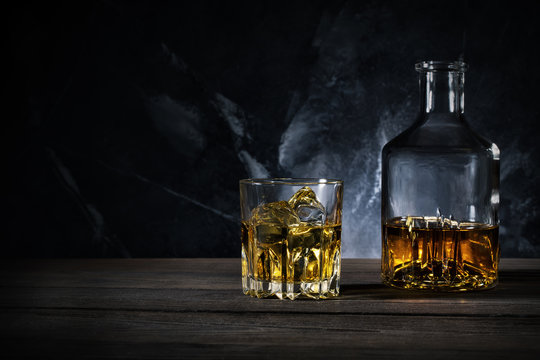 Decanter and glass of whiskey with ice