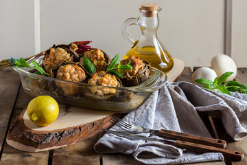 Delicious artichokes baked in the oven and stuffed with mushrooms and meat