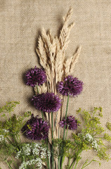 Overhead view of flowers on burlap