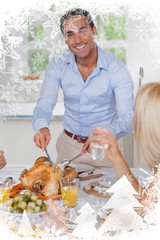 Smiling man carving the turkey against christmas frame