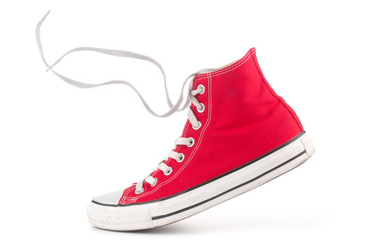 Single red sneaker on white background