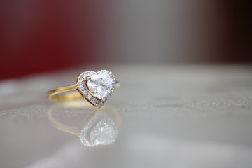 Diamond heart on gold ring