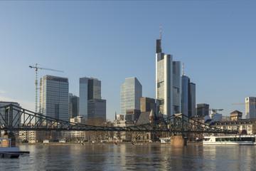 panoramic view of skyline of Frankfurt with old iron foot bridge