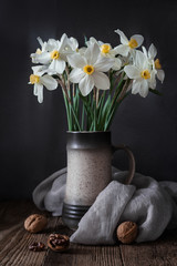 A bouquet of daffodils on a wooden background