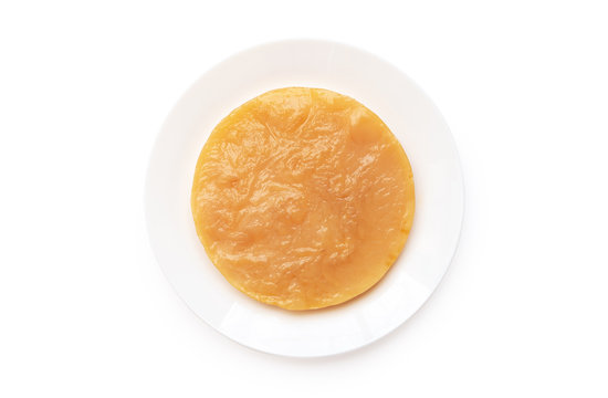 """healthy Kombucha SCOBY """"symbiotic culture of bacteria and yeast"""" on white plate isolated on white background"""