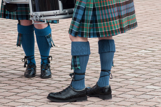 closeup of men legs with scottish kilt in the street