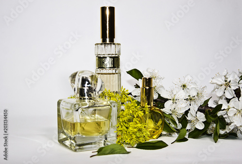 Perfume on a white background with snowy spring flowers of a linden perfume on a white background with snowy spring flowers of a linden tree mightylinksfo