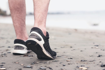 Man healthy jogging at the beach. Concept to life and health.