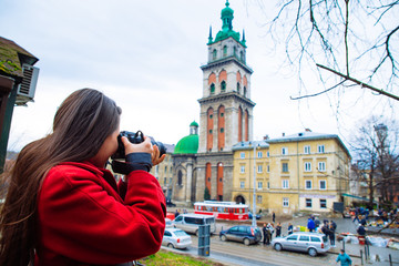 tourist woman taking picture of old european city. travel concep