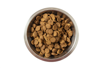 Dogs or cats dry food in a metal bowl isolated on white background, top view