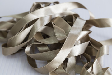 grey ribbon for textile on the ground.