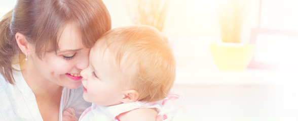 Happy family at home. Mother and her little daughter together. Maternity concept. Parenthood
