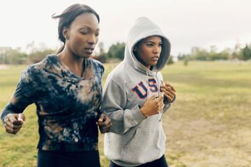 Two women jogging in park