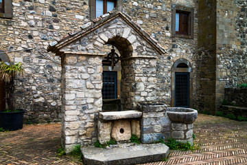 An ancient well of stone in the castle, a stone well