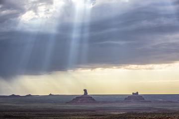 Stunning valley of the Gods against cloudy sky during sunset