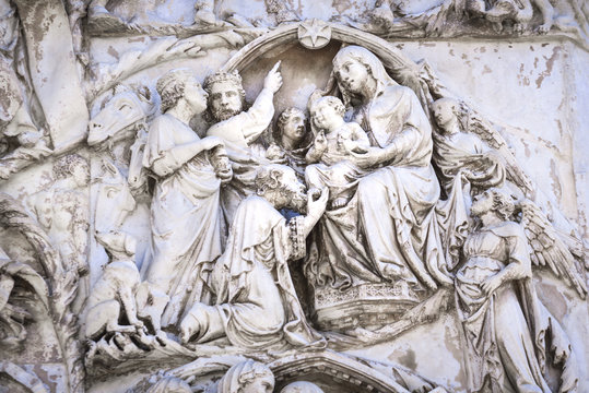 Detail of the facade of the Duomo of Orvieto, Italy. Marble bas-relief representing episodes of the bible. Adoration of the Magi