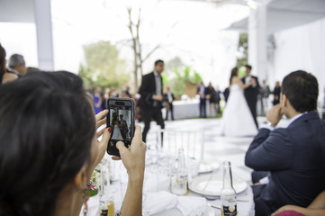 woman recording the bridal dance from her cell phone