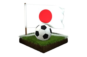 Ball for playing football and national flag of Japan on field with grass
